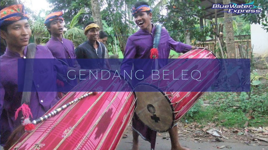 Young Sasak men playing Gendang Beleq, giant drums in the streets in Lombok, the new Bali.
