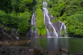 Banyumana Twin Waterfall is one of the best Bali waterfalls. Quieter than other falls, it has a clear waterfall pool you can swim in