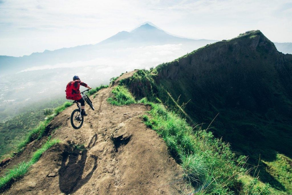 Downhill enduro cycling is probably the top pick for the adrenaline junkie level of adventure lovers