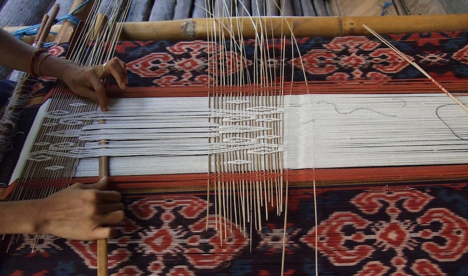 Ikat weaving is a style of textile creation used to make a lot of the traditional sarong you will see locals wearing